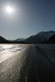 Water, sand, sky, mountains, sun