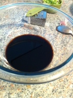 Mixing the sugar, rice wine vinegar and soy sauce.