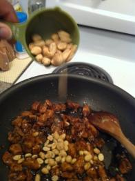 Adding the peanuts.
